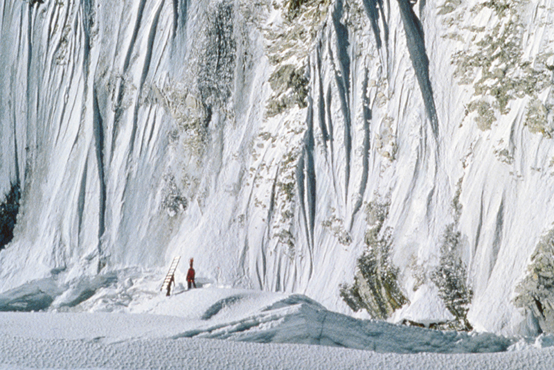 A climber looks tiny in the icefall below the world's highest mountain.